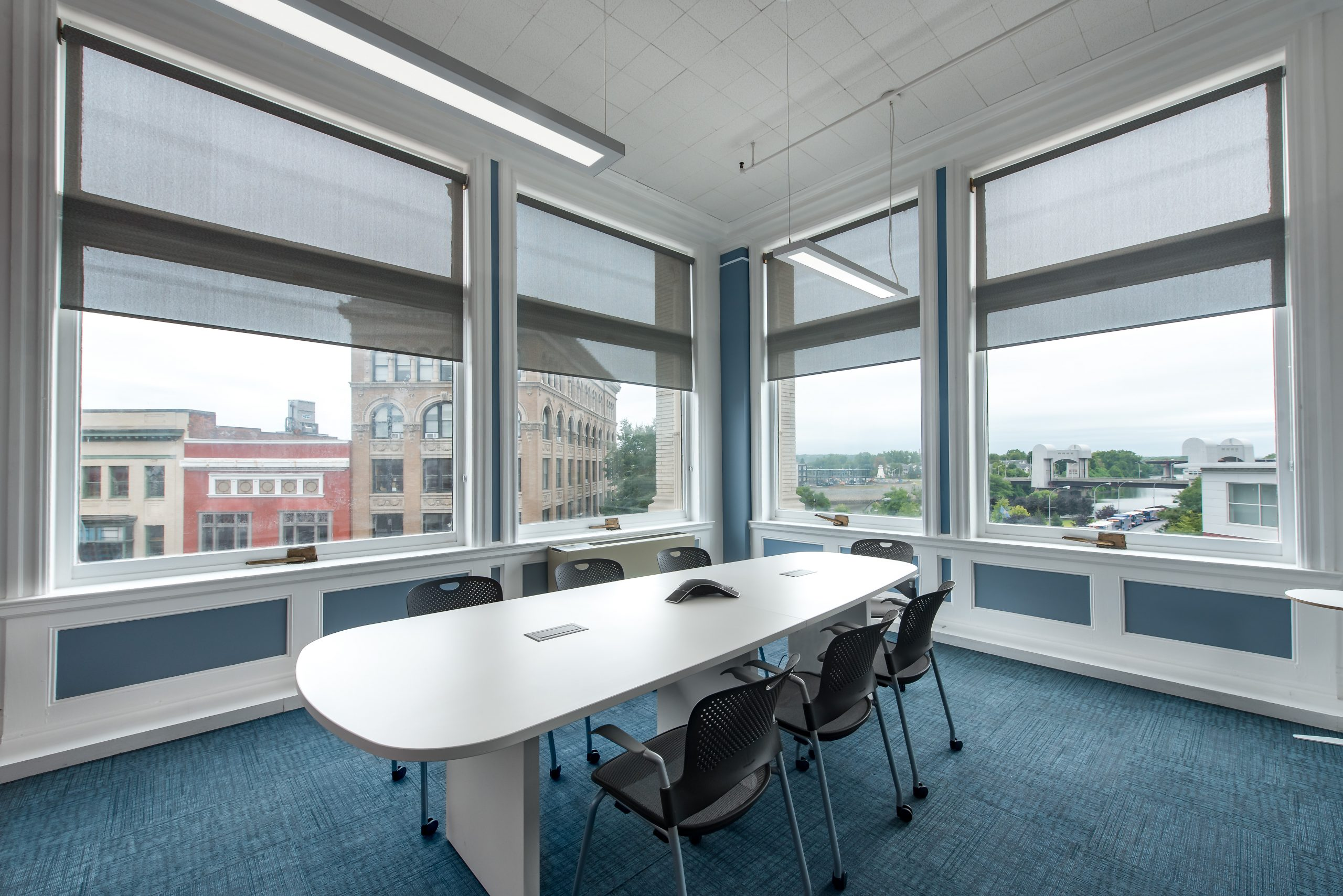 The Hudson Conference room, empty, with the windows facing downtown Troy.